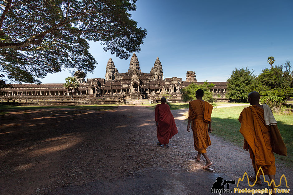 Monks entering n Angkor Wat temple photography tours