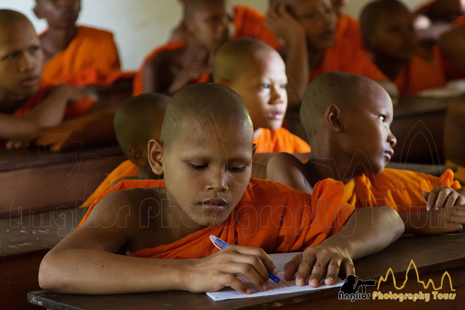 monk learning school angkor photography tour